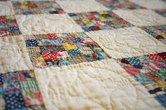 vintage postage stamp quilt; all hand-sewn ~ love the quilting on the white blocks