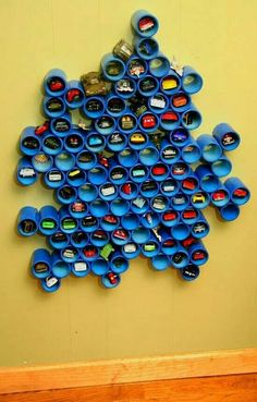 Another super creative ways to store all those Hot Wheels cars or craft supplies, use PVC pipe! Make an artsy design on the wall that acts not only as storage but some stylish texture as well. Then, fill it up with whatever needs to be kept at bay. Pvc Pipe Storage, Kids Storage, Storage Ideas, Organization Ideas, Creative Storage, Toy Car Storage, Storage Design, Wall Storage, Pipe Shelving