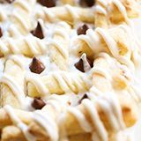 This HERSHEY'S KISSES Cream Cheese Pastry consists of buttery flaky puff pastry, a delicious cream cheese filling, is topped with HERSHEY'S KISSES Chocolates and drizzled with a creamy glaze. This dessert whips up in no time at all and tastes incredible! #sponsored (Direct link in profile)
