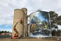 Artist Dvate at work on Rochester mural Work gets underway on the second of two Rochester silos receiving a street art treatment. Banksy, Industrial Artwork, Dazzle Camouflage, Art Du Monde, Melbourne Street, World Street, Murals Street Art, Building Art, Sculpture Art