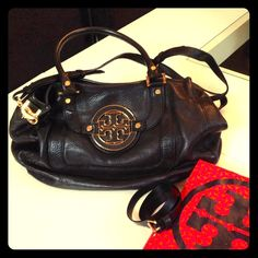 Black Tory Burch Bag Leather black Tory Burch so comfy and nice . Very light not heavy and fits a lot. some ware plz look at pics.. Tory Burch Bags