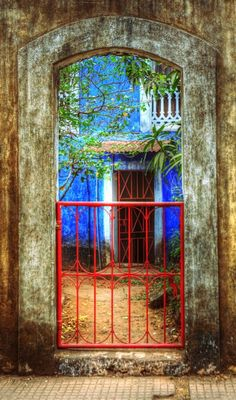 Portal in arched entry and cobalt blue painted villa Portal, Goa India, Arcade, Garden Gates, India Travel, Photos, Pictures, Incredible India, Windows And Doors