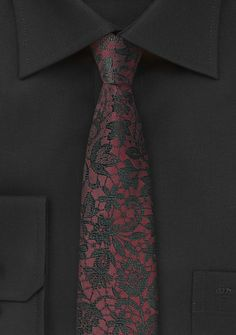 Striking wedding tie in burgundy and black with a floral pattern.