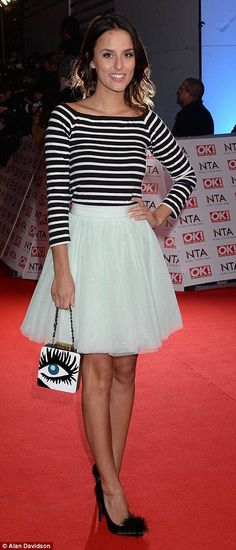 Varying styles: MTV presenter Laura Whitmore stood out in a black dress which features a v...