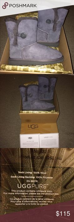 Brand NEW Grey Bailey Button UGG Boots In Box Brand NEW Grey Bailey Button UGG Boots still In Ugg box. Ugg Kids Girls (little kid/big kid) boot size 2 Little Kid M. Would make an excellent holiday gift! Super cute and incredibly warm. UGG Shoes Ankle Boots & Booties