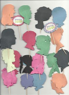 Silhouette cupcake toppers made with school colored paper and toothpicks, by Cindi Rose