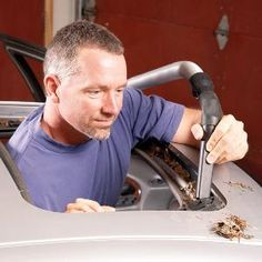 Solve most sunroof leak problems by clearing a clogged drain tube with your shop vacuum.