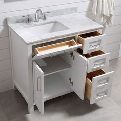 """The Tahoe vanity is the perfect solution big storage in a smaller space. Attention to detail and functionality are what really make this piece special. From drawers with built-in organizers to a flip-down front drawer, we made sure to utilize every inch of storage space. The Tahoe is appropriately complimented by modern chrome pulls and soft-close hinges and drawer glides. In addition a large 20"""" under mount ceramic sink topped with lavish Carrera white marble for a truly astonishing overall…"""