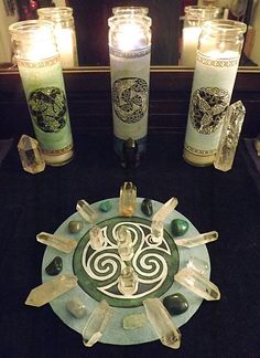 Celtic, perhaps pagan or Wiccan altar, judging from all of the Celtic knot-work, including the central circle on the altar cloth, made of a triskele, which usually stands for the triple goddess.  The creator also states that this altar evokes the month of March, and lists all of the gemstones.