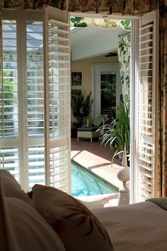 Plantation Shutters on Sliders - A close up view Sliding Patio Doors, Sliding Barn Door Hardware, Sliding Glass Door, Barn Doors, Shutter Hardware, Gate Hardware, Window Hardware, Glass Doors, Shutter Doors