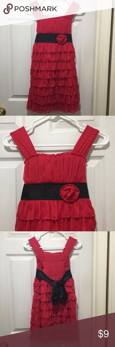 My Michelle red ruffle dress with black tie back My Michelle red ruffle dress with black tie back Size 10 Has inside liner dress Flower detail with rhinestone button on waist Midi length  Has some wear but still in great condition  100% polyester  Machine washable  All reasonable offers considered  Any questions please ask Thank you for looking  😀 Happy shopping 😀 My Michelle Dresses Formal