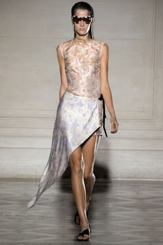 See the Maison Martin Margiela Spring 2015 runway show on Vogue.com.