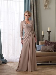 Beautiful dress.  We can order this from Maya's Palace here in Tucson.  Montage by Mon Cheri   Evening Gowns style #212946