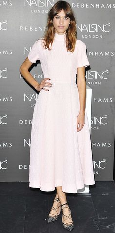 Alexa Chung in a demure blush-pink Emilia Wickstead high-neck, tea-length dress and strappy lace-up Bionda Castana pumps.
