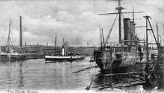 "In this early 1903 scene, the paddle steamer P. S. Strathmore of Captain John Williamson's fleet is heading down river and passing the Middleton shipyard now owned by the London & Glasgow Engineering and Iron Shipbuilding Co. Ltd. ( ""The Limited"" ) where the cruiser H.M.S. Cumberland is being fitted out for the Royal Navy."