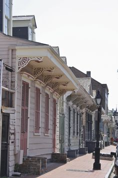 New Orleans architecture...I love the rows of houses with the detailing all painted