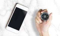 blank smartphone screen with hand on compass for gps mobile mock up