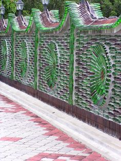 dences and wall design ideas to recycle glass bottlesGlass Recycling Ideas for Green Building and Outdoor Home Decorating Wine Bottle Fence, Plastic Bottle House, Bottle Garden, Bottle Art, Plastic Bottles, Magic Garden, Garden Art, Garden Design, Recycled House
