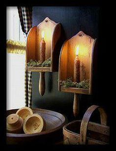 Vintage wooded scoops re-purposed as candle holders!