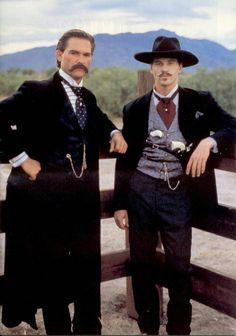 """Kurt Russel and Val Kilmer as Wyatt Earp and Doc Holliday in """"Tombstone."""" Favorite Doc Holliday line is """"I'll be your huckleberry."""" For me, this was Val Kilmer's best film, and he was the best Doc Holliday ever! Western Comics, Tombstone Quotes, Wyatt Earp Tombstone, Kurt Russell Tombstone, Old West, Movies Showing, Movies And Tv Shows, O Cowboy, Cowgirls"""