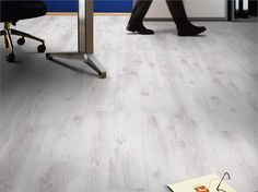 We love white floors, and this white oak design looks surprisingly at home in the office!