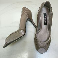 """NWT Nina Falana heels Beautiful perp toe design covered in satin. Fabric on toe and heels is pleated.  Gorgeous shoe with 3 1/2"""" heel. Nina Shoes Heels"""