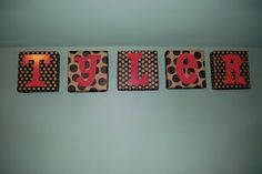 Letters glued on canvas covered in scrapbook pape
