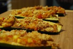 Crispy zucchini boats stuffed with tomatoes and onions in a creamy Parmesan and white wine mixture with crunchy breadcrumbs that will make your mouth water and your stomach happy.