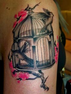 caged bird tattoo | Birds in a cage with cherry blossoms tattoo