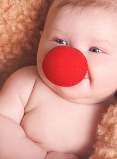 Creative baby photo shoots with a red clown nose prop!