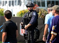 A Charlotte-Mecklenburg police officer watches foot traffic pass by Bank of America Stadium in Charlotte, NC on Sunday, September 25, 2016. The Carolina Panthers hosted the Minnesota Vikings in NFL action.