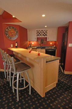 Lower level kitchen and bar with wine rack by S.J. Janis Company in Wauwatosa, WI.