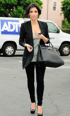 Black blazer, sea foam green top, black skinny jeans, black pumps with oversized bag.