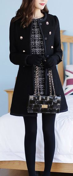 Classy patterned dress, feminine black parka, black tights/gloves/bag.