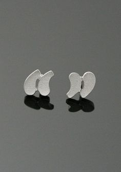 Quotation earrings in 925 silver from Signs Collection.Dimensions: 1 x 0.9 cm. OMG!  Chao & Eero, Finnish design, from Birik Butik.