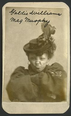 Historic Nebraska Mug Shots, Goldie Williams, alias Meg Murphy. She defiantly crossed her arms for her Omaha Police Court Mug Shot. Arrested on January 29, 1898 for Vagrancy.