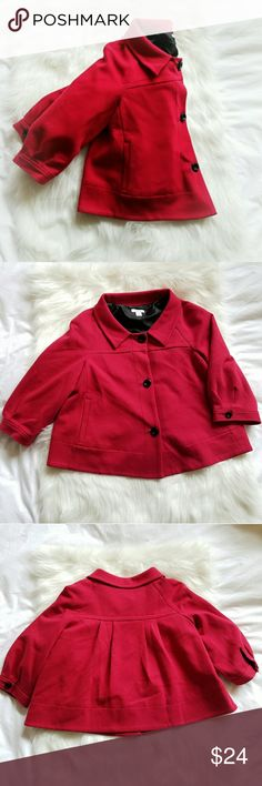 """{Dockers} Swing Shrug Jacket Oh my goodness. This Dockers blazer - meets - jacket is so darn cute!   Has a lighter peacoat/cape/bolero vibe. Cotton/polyester blend means it's extraordinarily cozy. Great for all seasons. Has a bit of cushy weight, but isn't heavy at all. Bright red = perfect for the Christmas holidays! Light enough to be worn year-round.  Lays beautifully on the upper torso, flaring out. 23"""" bust across. 17.5"""" shoulder-to-shoulder. Slightly cropped. 23"""" long. 3/4 sleeves w…"""