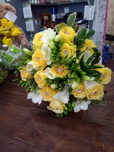 Lemon roses and white freesia bridal bouquet