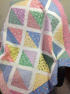 I like this simple but pretty design.... would be great for using up some of my scraps!Baby quilt in circa 1930s fabrics half square triangles with white frames