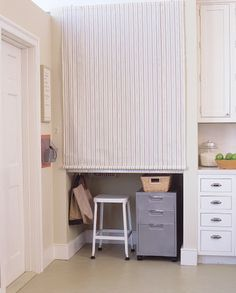 A roll down shade makes it easy to hide a workspace in an alcove.