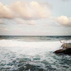 This picture doesn't do justice.  This little kid was jumping into big swells during Sydney's bad weather #rebel #adrenaline #bronte #bonditobronte #travel #travelaustralia #travelgram #vscogram #vsco #vscocam #blogger #sydney #home #beach #ocean #seeaustralia by lanz122 http://ift.tt/1KBxVYg