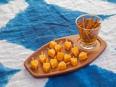Cut cheddar cheese sticks into squares, and snip off the ends so they resemble dreidels. Use a toothpick to make a hole in the top of the cheese, and place a small pretzel stick inside. Hanukkah 2019, Hanukkah Food, Feliz Hanukkah, How To Celebrate Hanukkah, Hanukkah Decorations, Hannukah, Happy Hanukkah, Hanukkah Celebration, Hanukkah Traditions