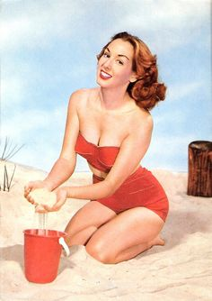 Sandcastle fun in a cheerful lipstick red two-piece 50s swimsuit.