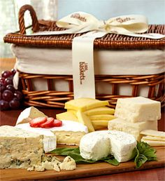 Cheese gift basket. Hmmmm( my speed would be a inexpensive basket full a personal & great goodies they might like!