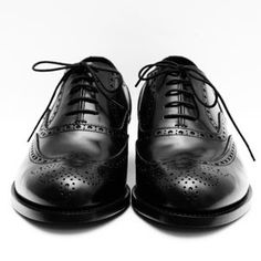The key is finding shoes that are properly constructed — that means a Goodyear welt, good leather, and a classic rounded toe. For one thing, they'll last longer, and for another, when the soles give out, you can get them fully resoled. Start with one simple black pair for office, evening, interviews, and funerals, and then one mid-brown pair for weekends and such. Add a pair of casual lace-ups like saddle shoes and a heavier casual shoe (or even a boot for winter) and you should be set.