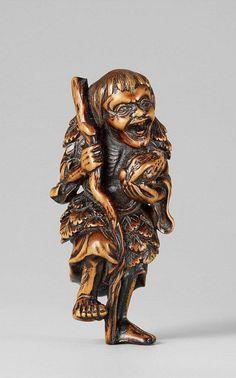 A boxwood netsuke of a laughing Gama Sennin. 19th century