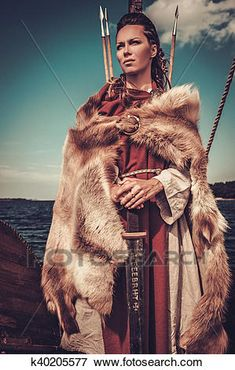Viking woman with sword and shield standing on Drakkar. View Large Photo Image