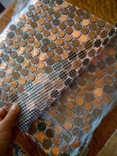 a penny saved. is a tile floor! She used a mosaic mesh to make penny tiles for an entryway area. Might be useful in thinking about the TILE mosaic table top I'm thinking about - and the penny floor is interesting, too. great how to link Penny Boden, Penny Tile Floors, Penny Backsplash, Kitchen Backsplash, Copper Backsplash, Tiled Floors, Penny Countertop, Wood Countertops, Home Projects