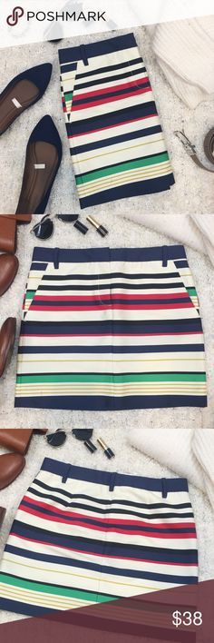 "J. Crew multicolor striped mini skirt This unique J. Crew mini skirt is in great, like new condition! Features front zip and hook closure with a waist measurement of about 30"", and a length of about 16"". The stripes are different sizes of black, cream, navy blue, red, green, and a mustard yellow. The ""pockets"" are more for looks and are sewn shut. Size 2. 93% Cotton, 7% Nylon. J. Crew Skirts Mini"