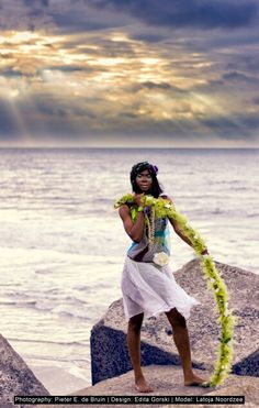 Strong and forceful Latoya surviving the wind and looking beautiful in her colorful fantasy